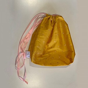 Shiny yellow drawstring bag